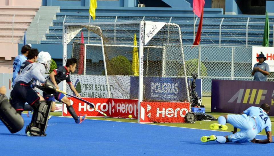 SVSunil scores Indian hockey team's first goal against Japan in their Asia Cup hockey opening match inDhaka onWednesday.
