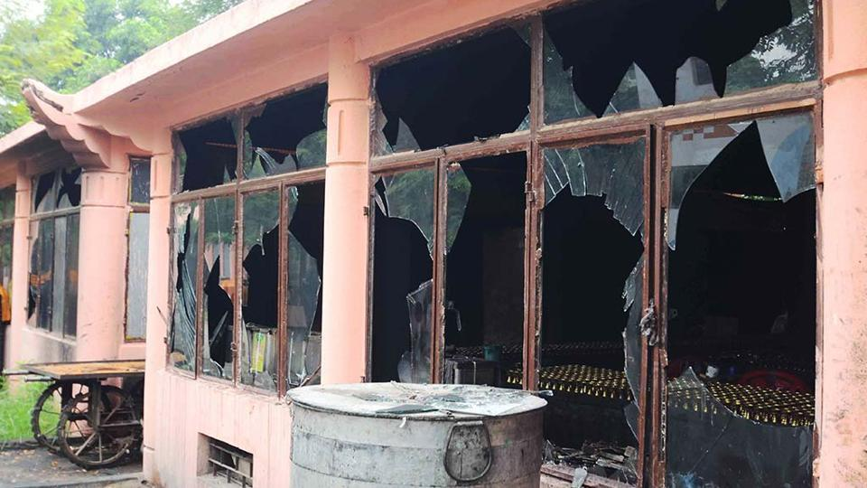 Broken windows at the Bodh Gaya Buddhist temple complex after low intensity-blasts took place on July 7, 2013.