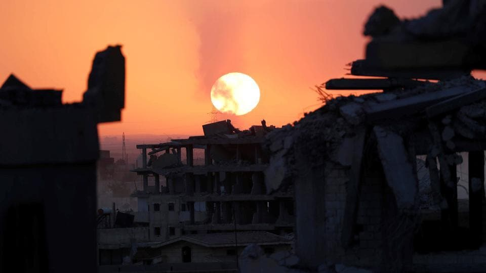 Destroyed buildings are pictured during sunset in Raqqa. Both the US spokesman Dillon and the SDF fighter Babel say that some Islamic State fighters are surrendering. Interrogations of those surrendering reveal ISIS had dug a tunnel between the hospital and stadium. At the front line, morale among SDF fighters remains high. One fighter for instance belted pop music to other units over his walkie talkie. The battle is expected to last between seven to 10 days. (Erik De Castro / REUTERS)