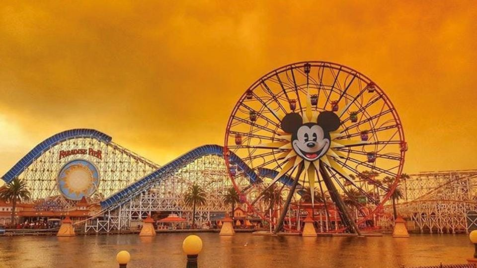 Disneyland is seen as wildfires cloud the sky across northern California, in Anaheim. Wildfires whipped by powerful winds swept through California wine country, killing 17 people, injuring at least 100, while destroying 2000 residences and buildings as the flames raged unchecked through high-end resorts, grocery stores and tree-lined neighbourhoods. (Instagram /@KENNYA.BOULTER/Kennya Boulter via REUTERS)