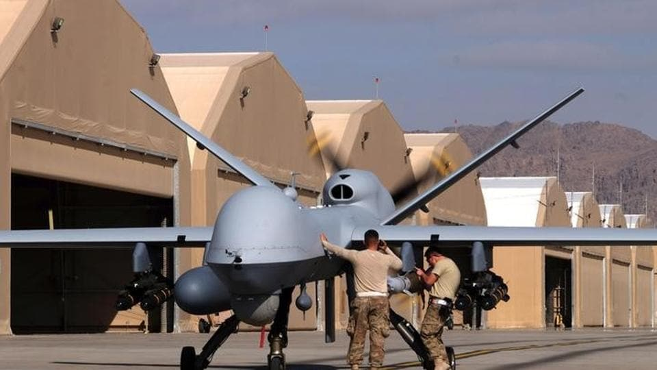 US airmen prepare a US Air Force MQ-9 Reaper drone as it leaves on a mission at Kandahar Air Field, Afghanistan March 9, 2016.