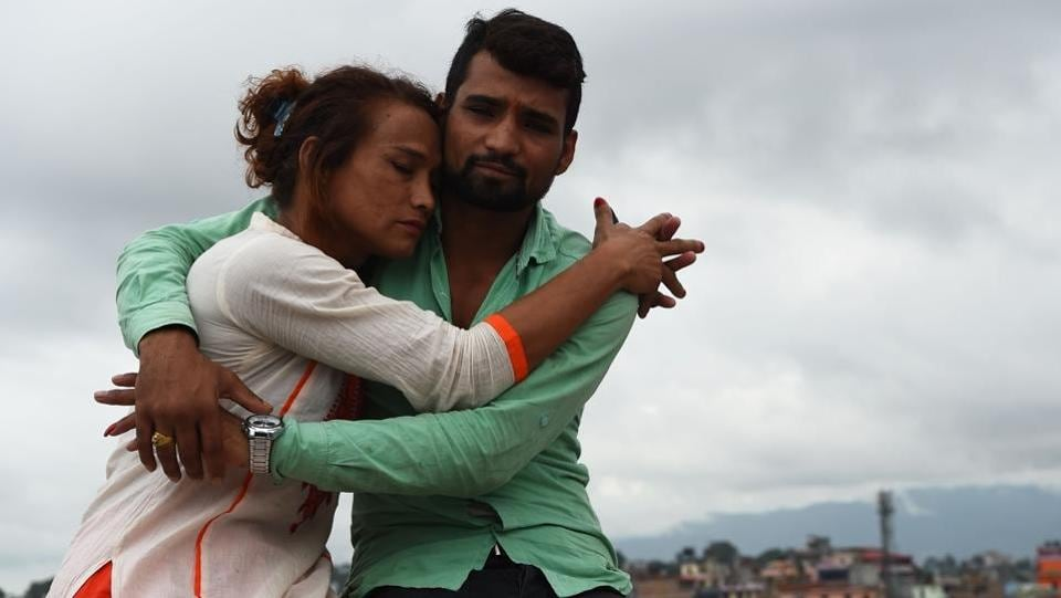 Nepali transgender woman Monika Shahi Nath (40) and her husband Ramesh Nath Yogi (22) in Kathmandu, sharing an emotional moment. She became Nepal's first transgender woman to be issued a marriage certificate by district officials in May 2017 even though Nepal has no laws for such unions. (Prakash Mathema / AFP)