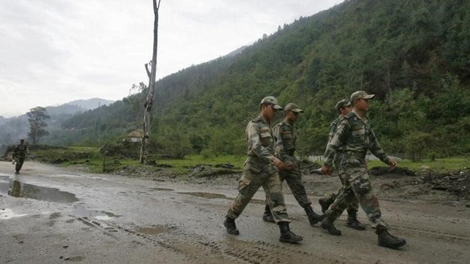 A file photo of army soldiers marching near an army base on India's Tezpur-Tawang highway.