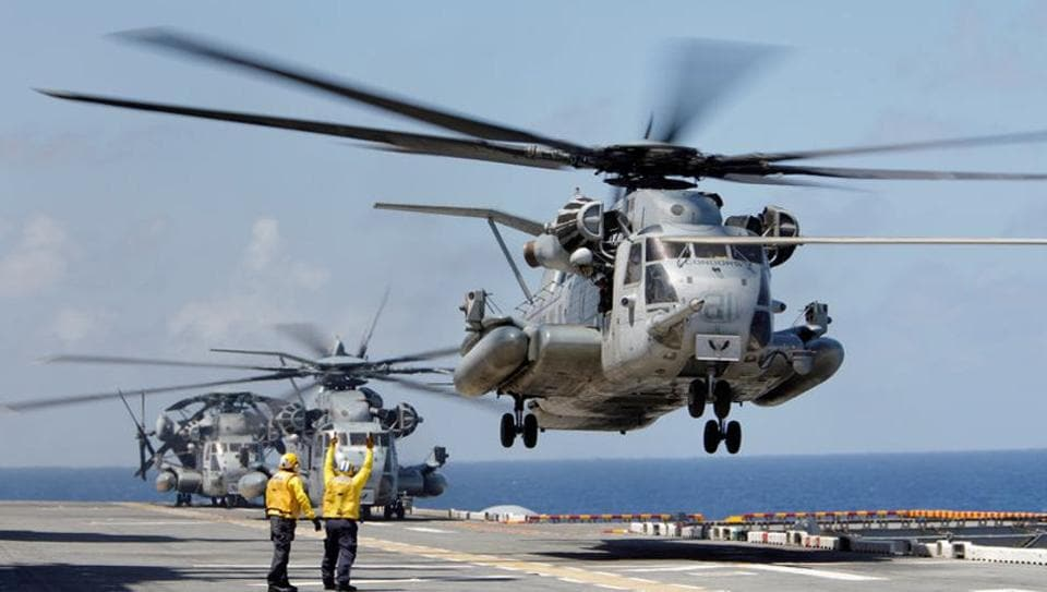 File photo of a Marine Corps CH-53 Super Stallion lifting off from the USS Kearsarge.