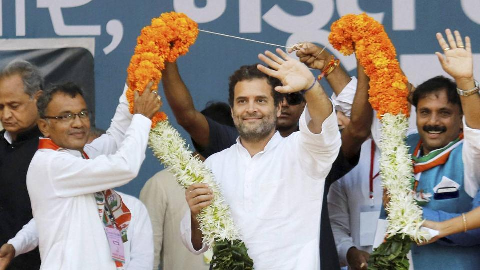 Congress party vice president Rahul Gandhi being garlanded during a public meeting at Bodeli in Chhota Udaipur district of Gujarat on Tuesday.