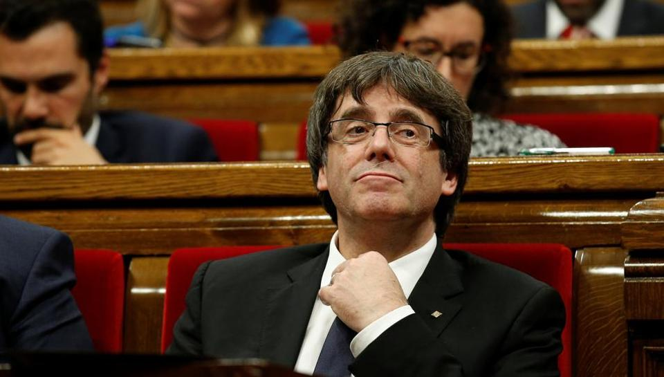 Catalan President Carles Puigdemont gestures during a plenary session in the Catalan regional parliament in Barcelona, Spain, October 10, 2017.