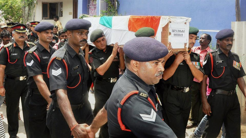 Army personnel carrying the coffin of Sepoy E Balaji, who was killed in an Indian Air Force helicopter crash in Arunachal Pradesh, during his last rites at Kolapakkam, Chennai on Monday.