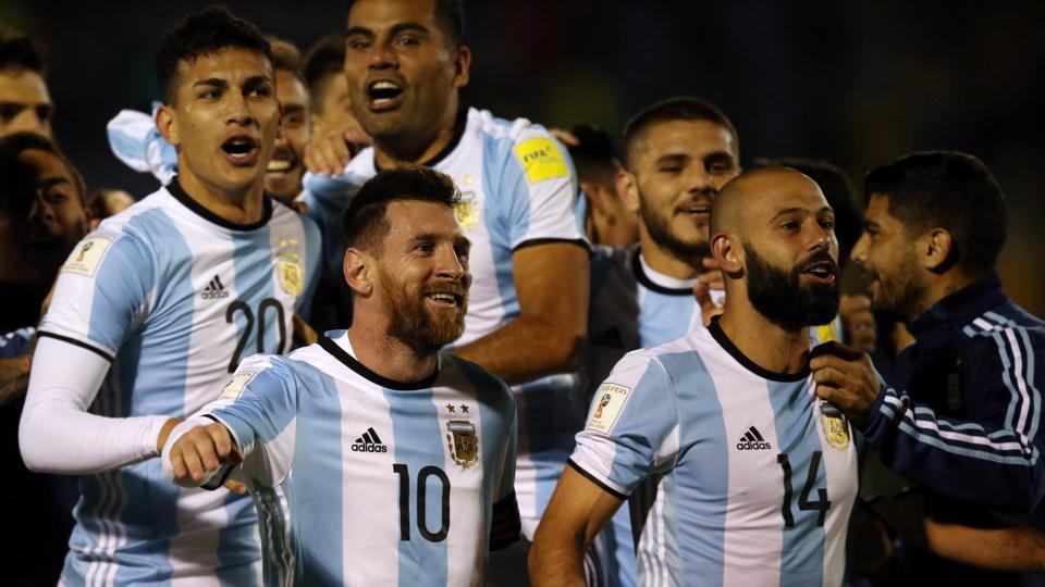 Argentina's Lionel Messi, Javier Mascherano (14) and other teammates celebrate after beating Ecuador in Quito to qualify for the 2018 FIFAWorld Cup.