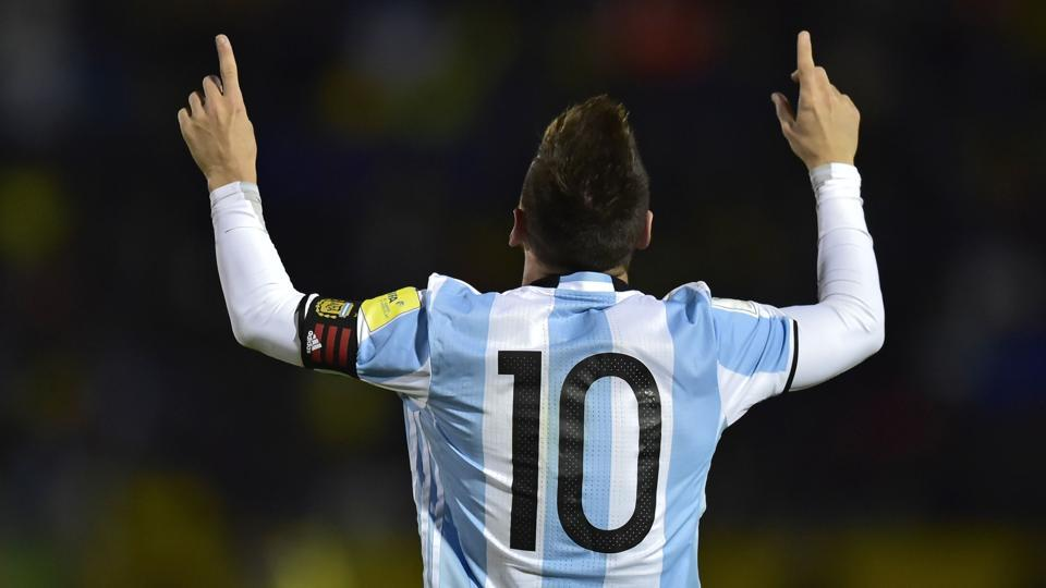 Argentina's Lionel Messi celebrates after scoring his third goal against Ecuador during their 2018 FIFAWorld Cup qualifier in Quito, on October 10, 2017.