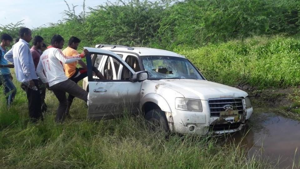 Locals vandalise the vehicle that ran over two teenagers.