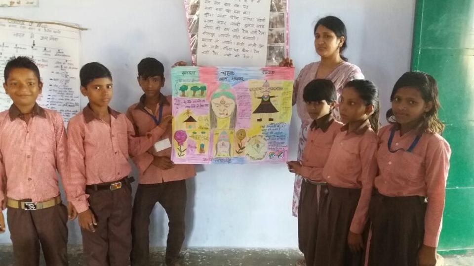 Students and their teacher with the newspaper.