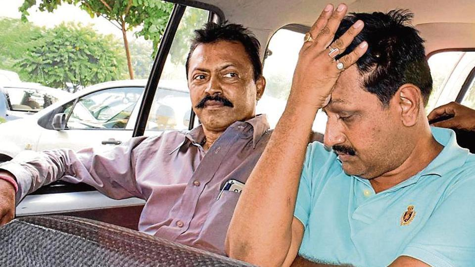 The CBI taking one of the accused (right) to a court on Wednesday.