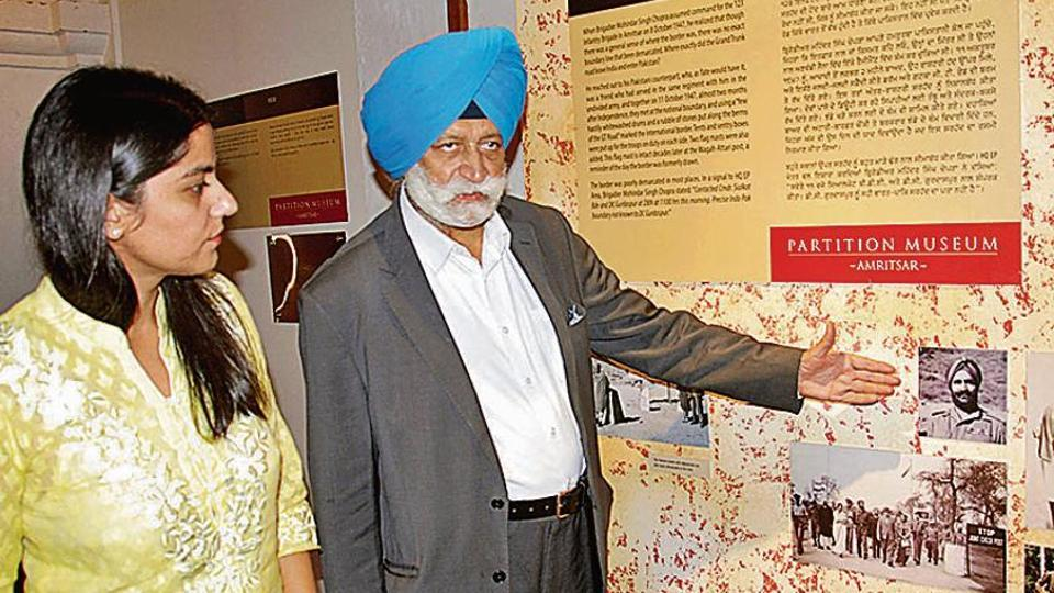 Pushpinder Singh Chopra, son of Brigadier Mohindar Singh Chopra, and Partition Museum CEO Malika Ahluwalia next to photos of the brigadier and others related to the India-Pakistan border demarcation, in Amritsar on Wednesday.