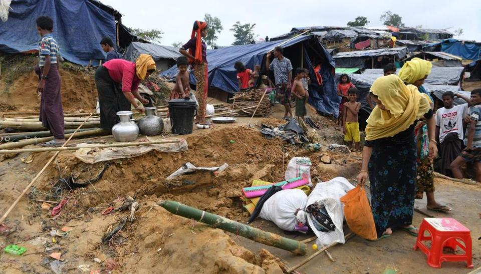 Rohingya refugees dismantle their makeshift home to move to another camp at the Palangkhali refugee camp in Ukhia district on October 12, 2017.