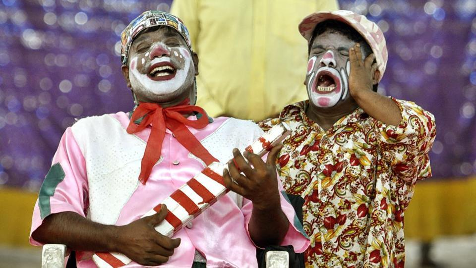 Two clowns share a light moment at the Asiad Circus, while on tour in eastDelhi. One of the most popular acts in the circus, clowns, ironically, find little acceptance in the world outside a circus.  (Sanchit Khanna / HT PHOTO)