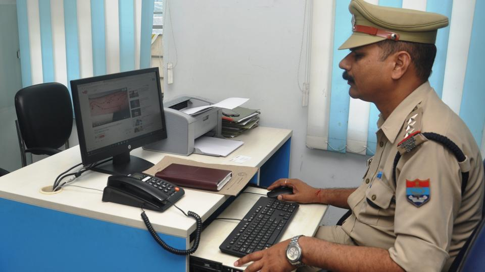 An officer of Dehradun Police's Cyber Crimes division at work.