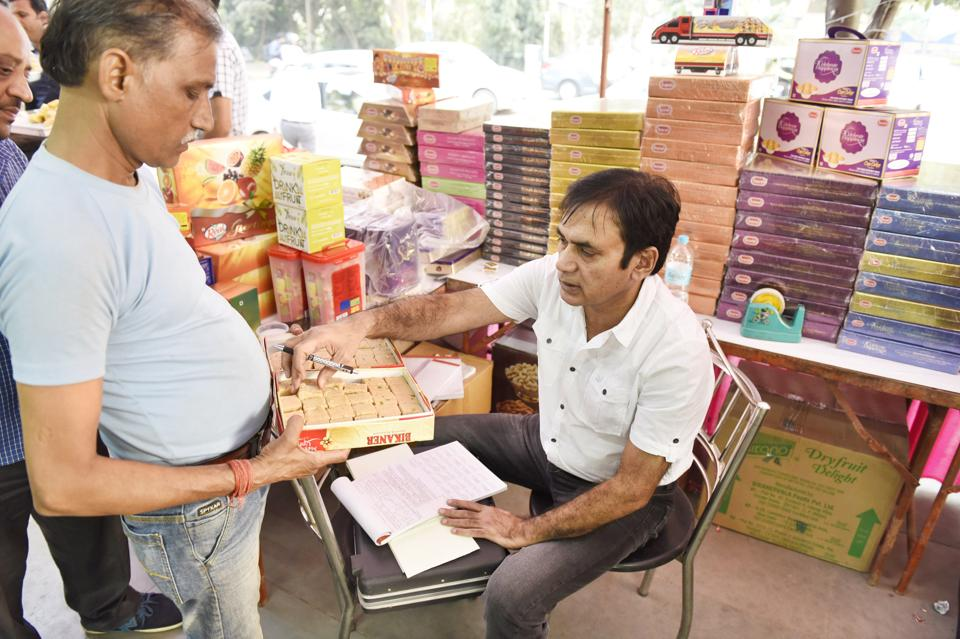 KK Sharma, Gurgaon's food safety officer, checks samples at a sweet shop on Thursday.