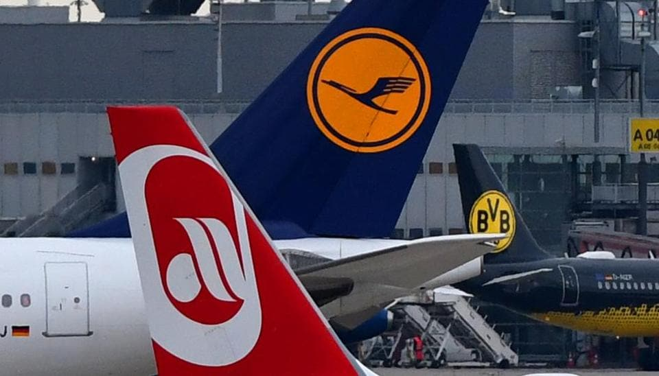 An airplane operated by German airline Air Berlin rolls on the tarmac past a Lufthansa plane on October 10, 2017 at Duesseldorf airport, western Germany.