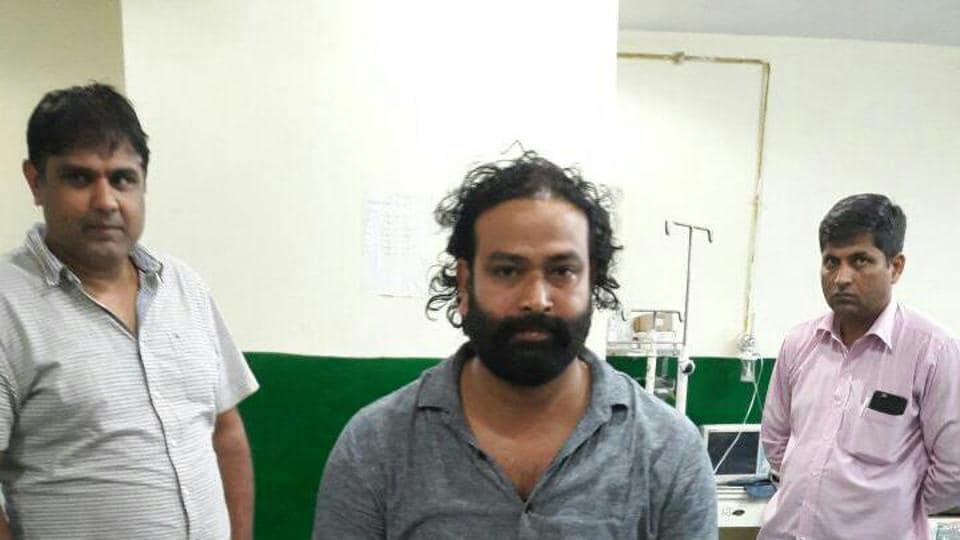 Gangster Akhilesh Singh at a hospital after his arrest at Gurugram in Haryana