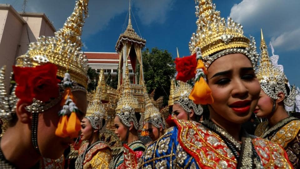 Thai dancers gather at the Great Victory Royal Chariot that will carry the late King Bhumibol Adulyadej's body in a giant ornate urn to the cremation site, in Bangkok, Thailand. The nation is putting the finishing touches this month to a lavish five-day funeral ceremony in a final goodbye to its monarch, who helped shape the Southeast Asian nation for decades after World War Two. (Athit Perawongmetha / REUTERS)