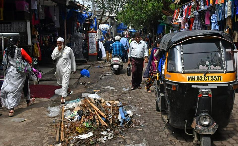 An autorickshaw drives though Masjid galli at Andheri on Wednesday.