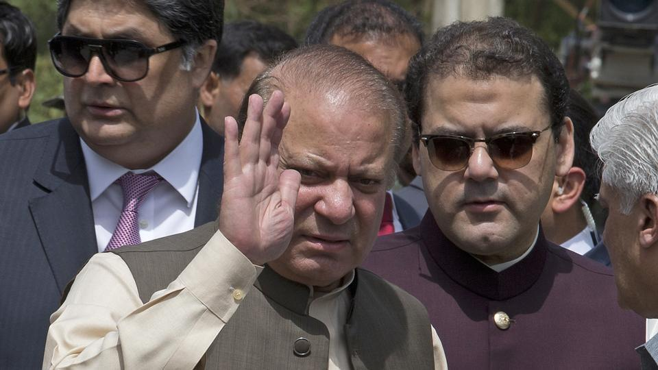 Pakistan's ousted Prime Minister Nawaz Sharif with his son Hussain Nawaz, right, outside the premises of the Joint Investigation Team, in Islamabad, Pakistan.