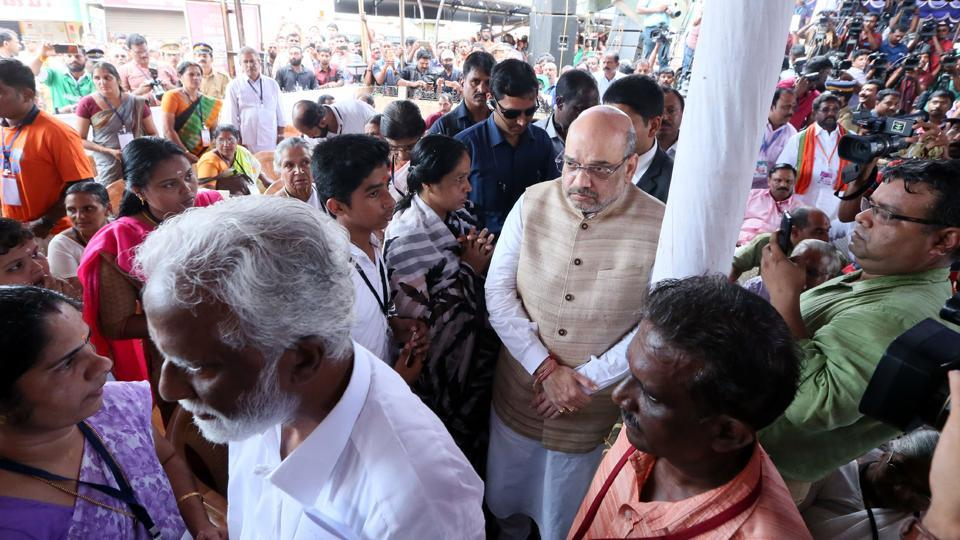 BJP president Amit Shah goes through a photo exhibition of pictures of party workers killed in political violence in north Kerala's Kannur district.