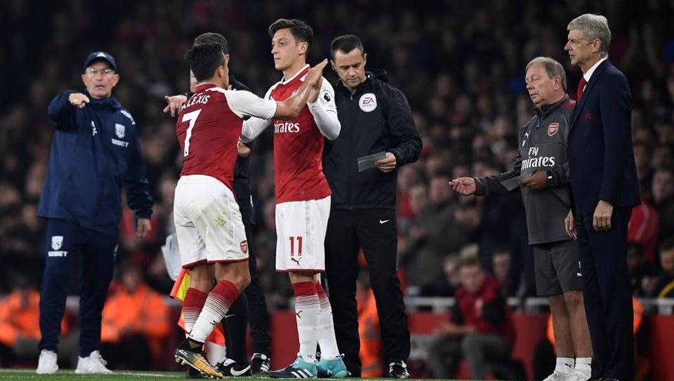 Arsenal's Mesut Ozil and Alexis Sanchez could leave the Premier League club in January 2018, said manager Arsene Wenger.