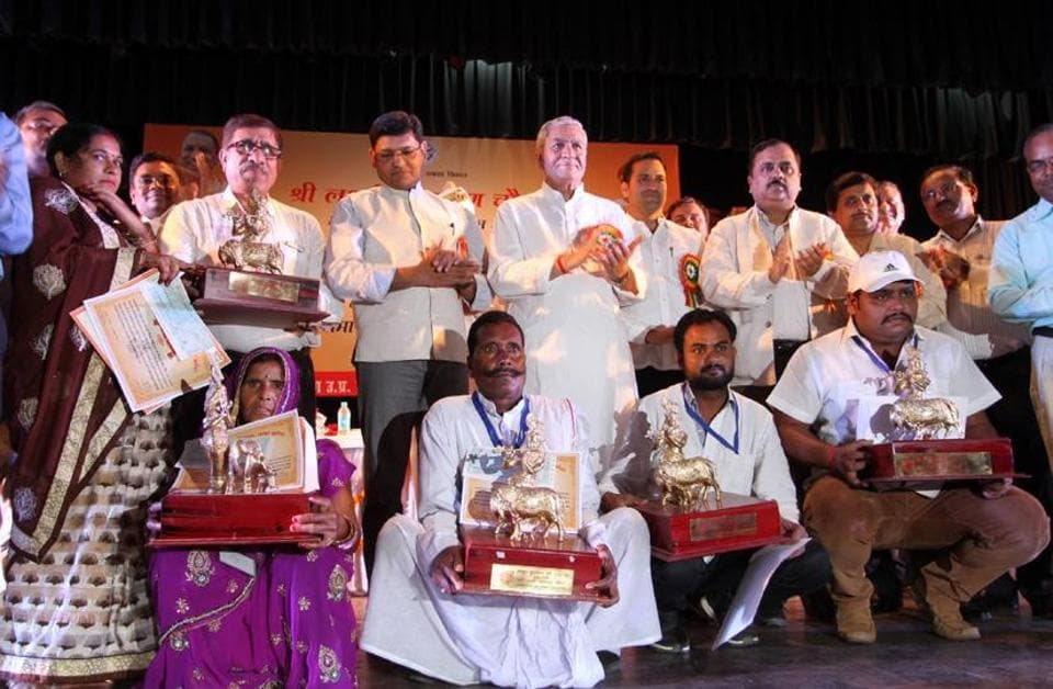 Cabinet minister for dairy development, Laxmi Narayan Chaudhary with the recipients of Gokul Awards at Ganna Sansthan in Lucknow.