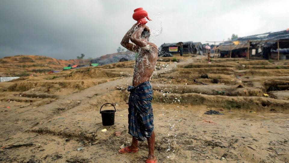 A Rohingya refugee washes at a refugee camp in Palong Khali district in Cox's Bazar, Bangladesh, on October 12, 2017.