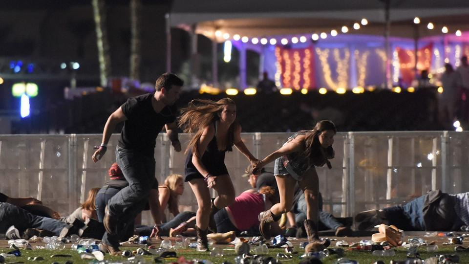 People run from the Route 91 Harvest country music festival after apparent gun fire was heard on October 1 in Las Vegas.