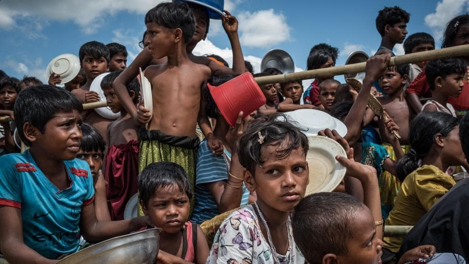 Rohingya refugee children line up for food outside Cox's Bazaar in Bangladesh.