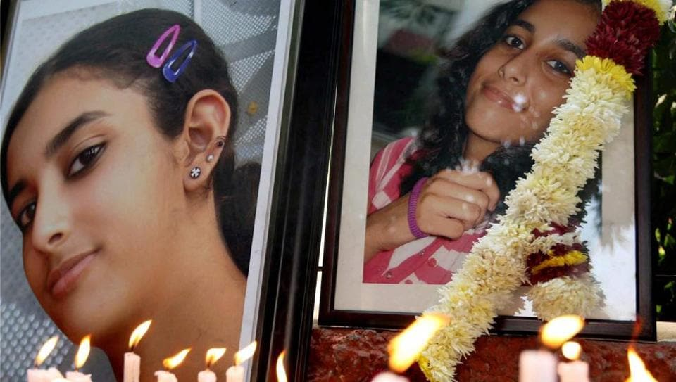 In this file photo friends and relatives of Aarushi Talwar light candles near her portrait to seek justice for her, at Jantar Mantar in New Delhi in Jan, 2016.