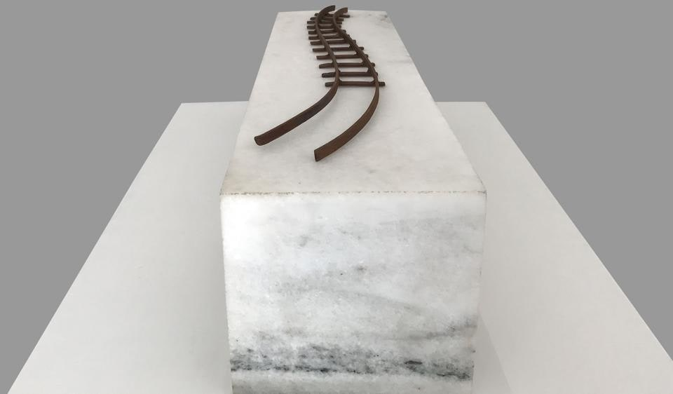 The installation Crossing Frozen Clouds places a curvy track on a block of white marble at Sumedh Rajendran's show.