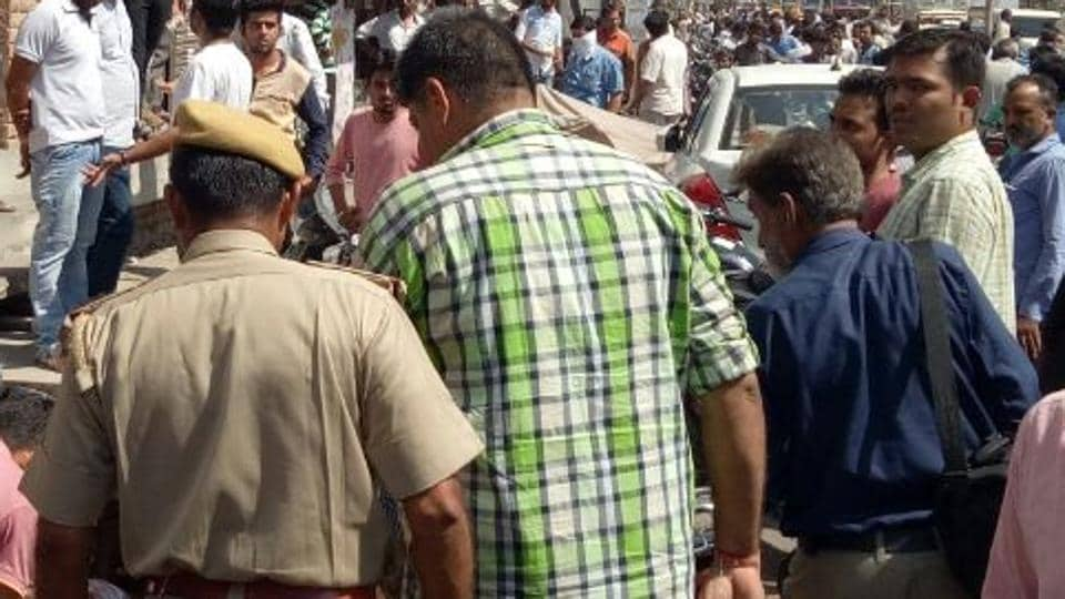 Police rescue a Muslim man who was brutally assaulted by a mob after being caught with a Hindu woman in a hotel room.