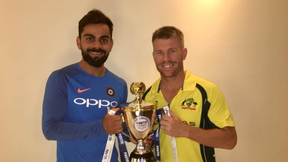 India captain Virat Kohli and Australia skipper David Warner share the T20I trophy after the India vs Australia game was abandoned due to a wet outfield.