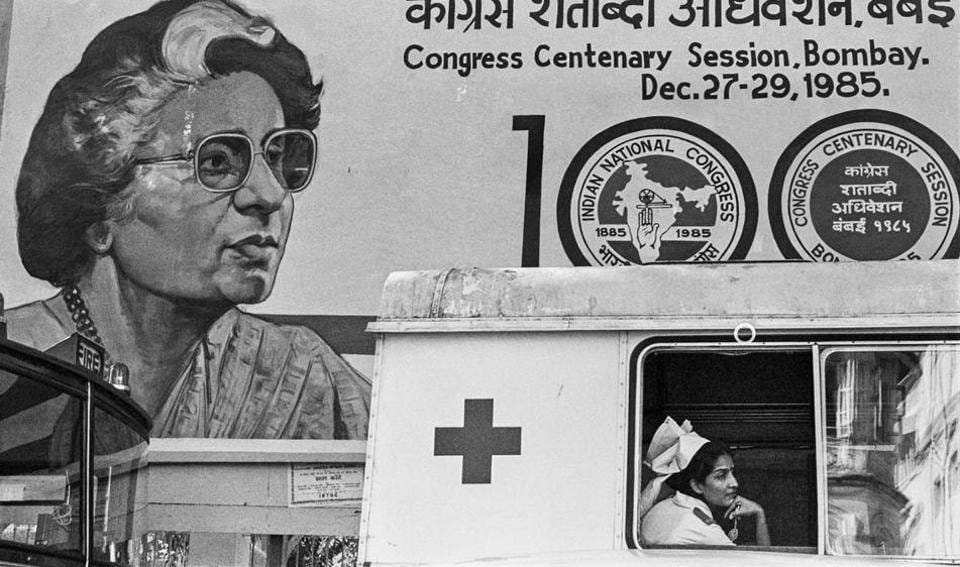 Nurse and poster of Indira Gandhi at the Congress Centenary Session, Bombay 1985