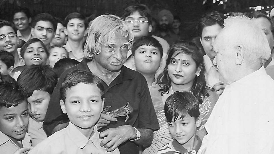 In this July 2002 photo, Dr. APJ Abdul Kalam is seen interacting with children in Delhi. A role model for students and young people alike, Kalam was always happy to split his time between them and educational institutions. (HT Photo)
