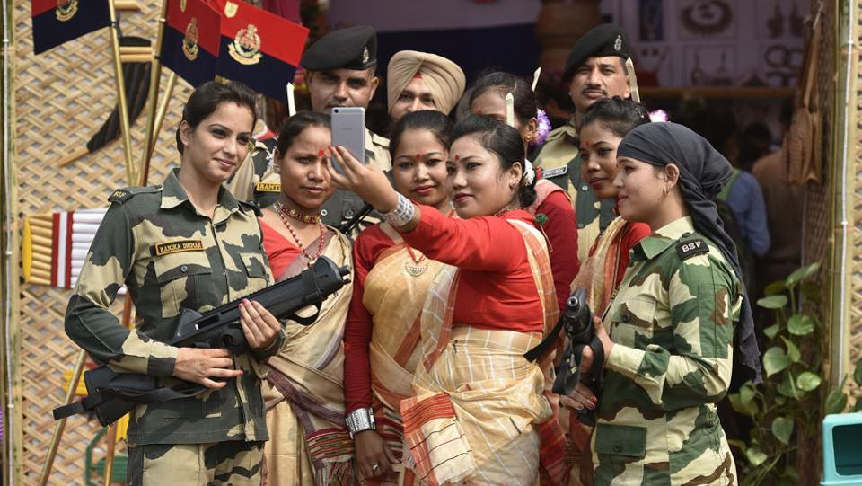 BSF Jawans from Assam take a selfie with commandos during the BSF Annual Welfare Meet and Exhibition 2017 at  Dayal Singh college ground in New Delhi, India, on Friday, October 13, 2017. The meet will continue until Oct 15, 2017.  (Raj K Raj / HT  PHOTO)