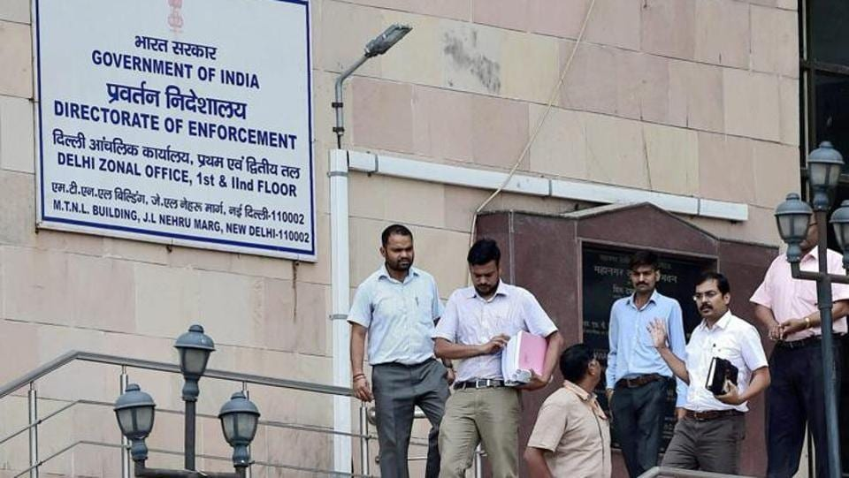 Officials at the Directorate of Enforcement office  in New Delhi.