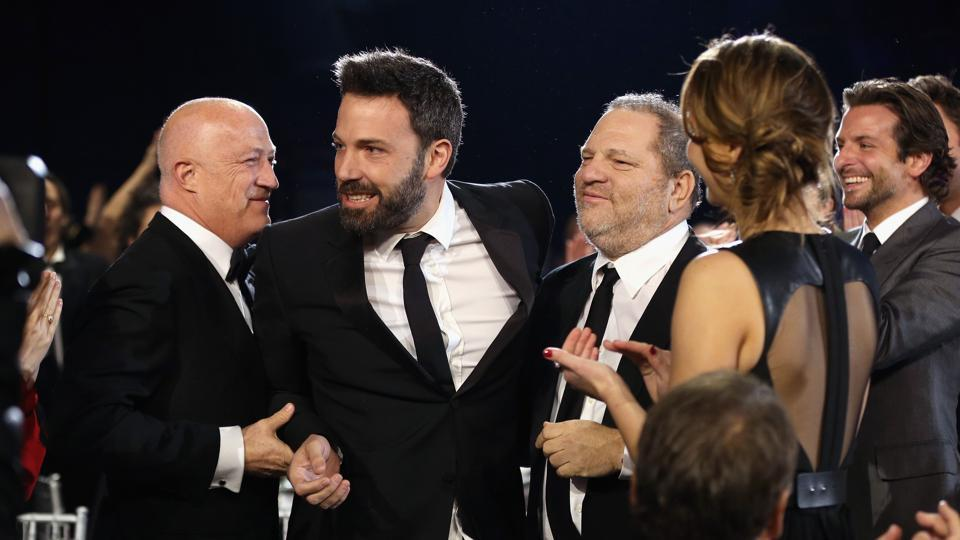 (FILES) This file photo taken on January 10, 2013 shows (L-R) Co-Chairman of Creative Artists Agency Bryan Lourd, director Ben Affleck and co-chairmen of The Weinstein Company Harvey Weinstein attending the 18th Annual Critics' Choice Movie Awards held at Barker Hangar in Santa Monica, California.
