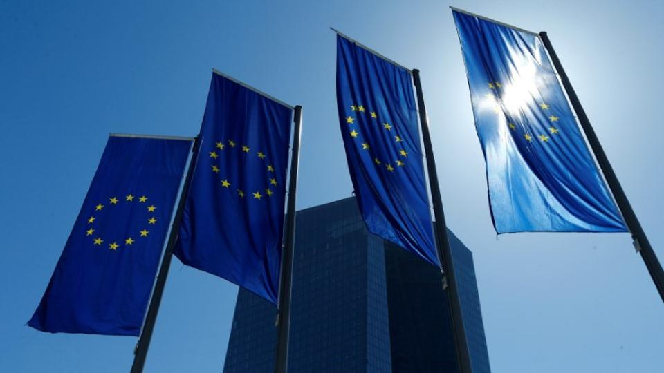 European Union flags flutter outside the headquarters of the European Central Bank (ECB) in Frankfurt, Germany, April 21, 2016.