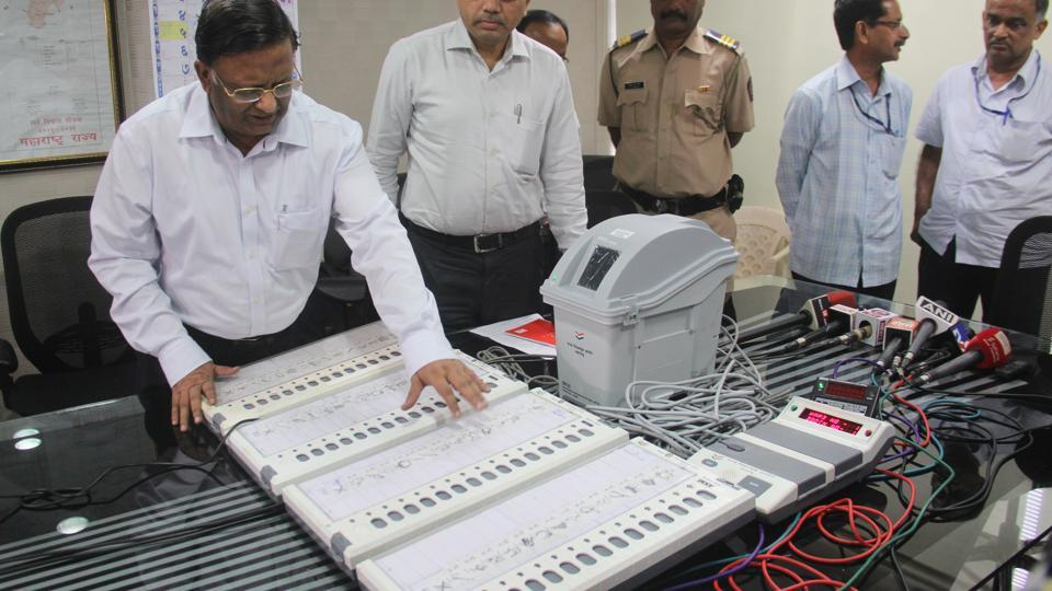 State Election commissioner, J S Saharia, inspecting a new Voter Verifiable Paper Audit Trail (VVPAT) machine in Nanded