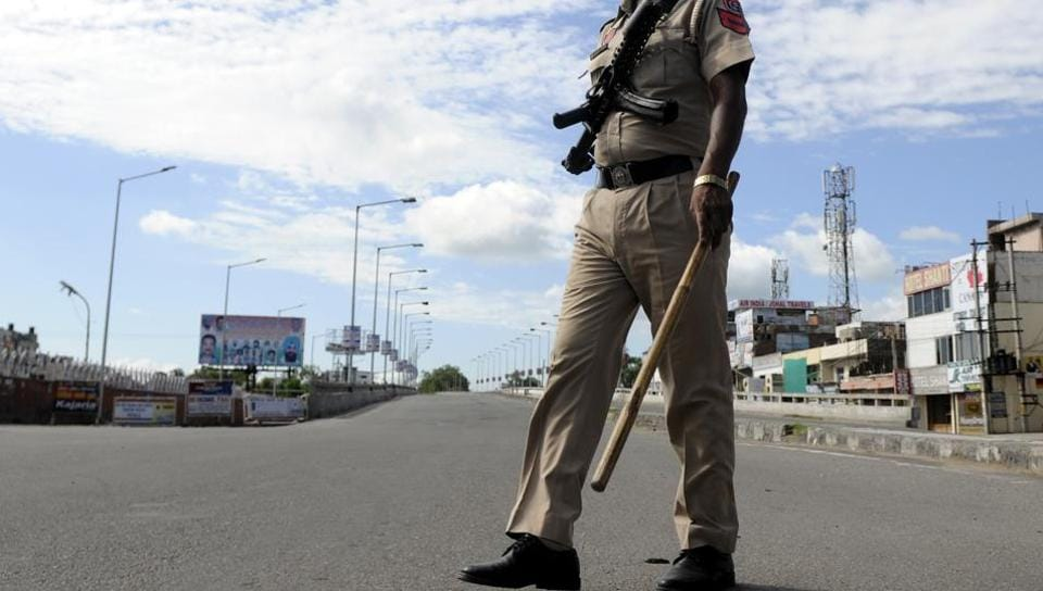 A policeman stands guard in Patiala.