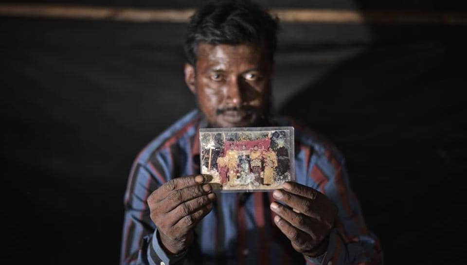The only personal possession Amir Hussain could carry with him during his arduous passage to India in 2009 was a family photograph. Most Rohingyas who flee Myanmar arrive with nothing other than legal documents and with rigs of clothes on their backs. (Burhaan Kinu / HT PHOTO)