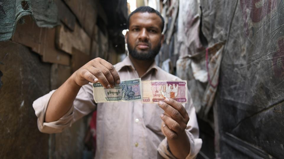 Mohammad Salimullah, one of the two Rohingya refugees who have petitioned the Supreme Court about the proposed deportation of the refugees from India, shows the Burmese currency notes which he had brought with him while fleeing his country in 2012. The Supreme Court of India has urged the petitioners to desist from making emotional arguments and personal attacks and to file documents, including international conventions. (Burhaan Kinu / HT PHOTO)