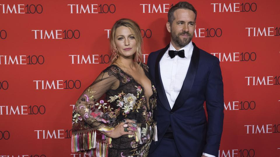 Blake Lively wears a Marchesa dress as she poses with her husband Ryan Reynolds at the TIME 100 Gala in New York.