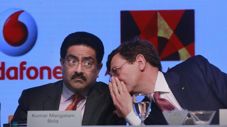 Vodafone Group CEO Vittorio Colao, right, talks to Aditya Birla Group chairman, Kumar Mangalam Birla during a press conference in Mumbai, India, Monday, March 20, 2017.