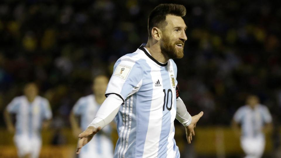 Argentina's Lionel Messi is seen celebrating after scoring his third goal against Ecuador during their 2018 World Cup qualifying soccer match at the Atahualpa Olympic Stadium in Quito, Ecuador. Messi's three goals lifted Argentina into the World Cup on the last day of South American qualifying, keeping the Argentines from missing out for the first time since 1970. (Fernando Vergara / AP)