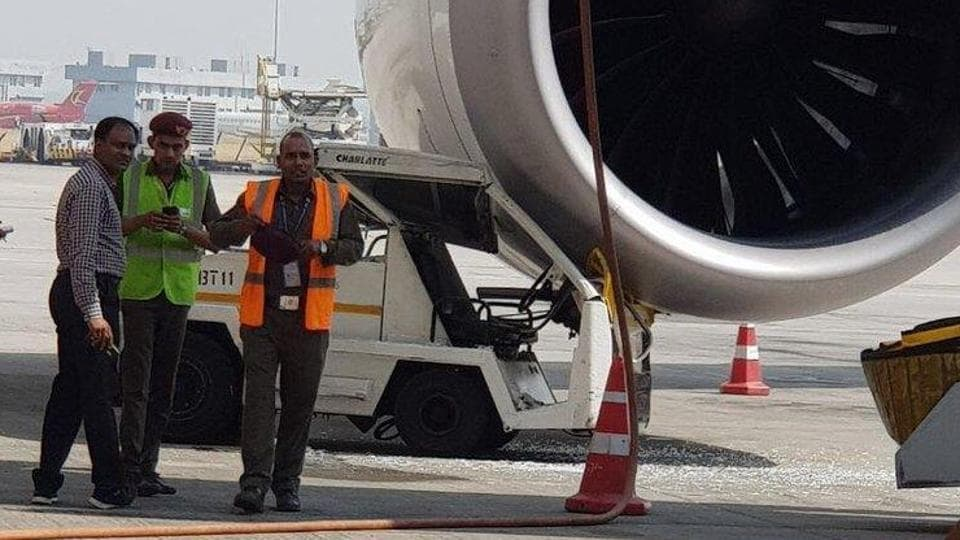 Electric baggage tractor hits engine of a Shanghai-bound Air India flight.